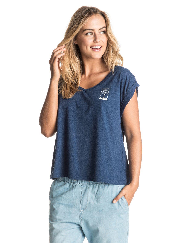 Женская футболка с подвернутым рукавом GuerreroСвободный и слегка угловатый крой, тонкая и нежная полусинтетика с вискозой и подвернутые рукава – все это очень гармонично сочетается с V-образным вырезом, который мы выбрали для этой женской футболки. Ткань в мелкую крапинку и трафаретные принты с тропическими мотивами будут особенно выигрышно смотреться с выбеленным денимом: джинсами, шортами или юбкой.<br>