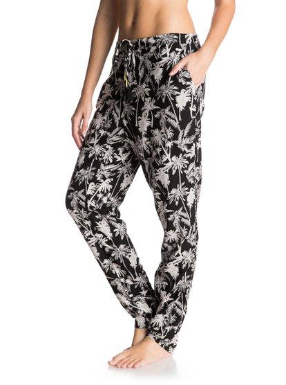 Womens Palm Trees Cover Up PantsПляжные женские штаны Palm Trees от ROXY. <br>ХАРАКТЕРИСТИКИ: свободный крой, низкая линия пояса, сплошной принт, эластичный сзади пояс. <br>СОСТАВ: 100% вискоза.<br>